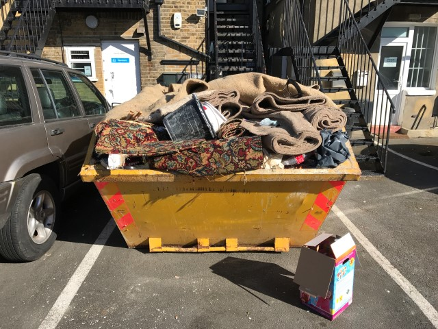 What are the risks of overloading a skip